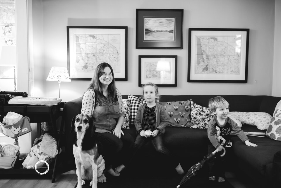 Family and dog together on couch.