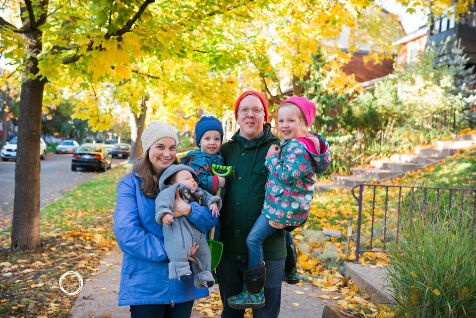 Family of five outside in the fall leaves in Ottawa.