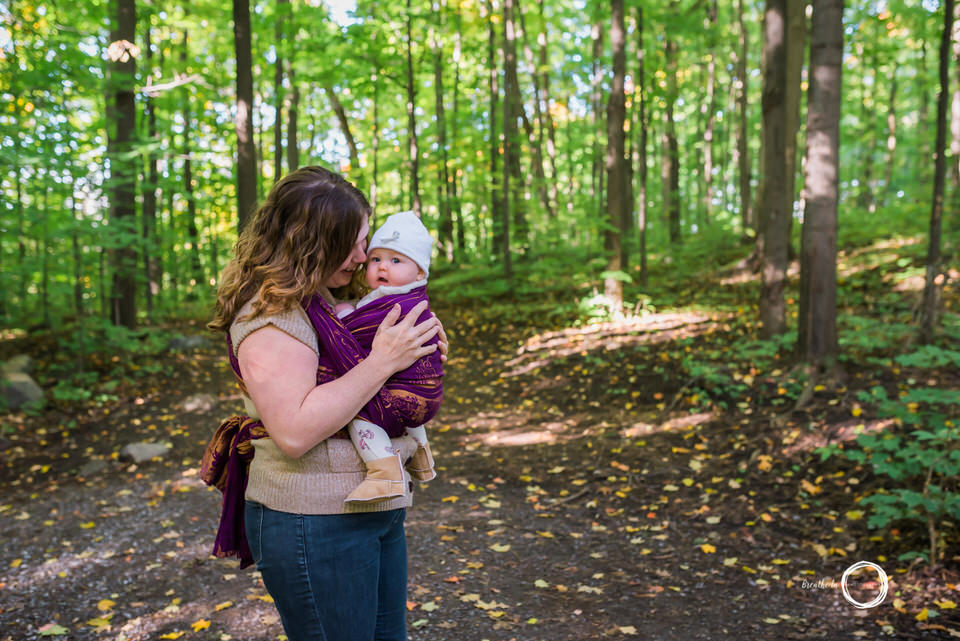 Babywearing Mom and baby in Ottawa in forest.