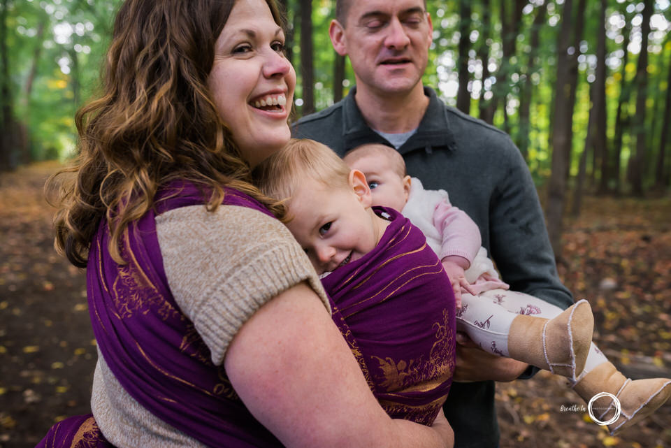 Toddler babywearing snuggles with Mom in Ottawa during lifestyle session.