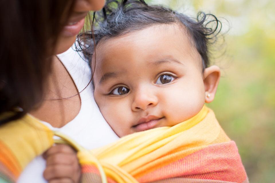 Baby brown eyes smiling in Girasol at Petrie Island