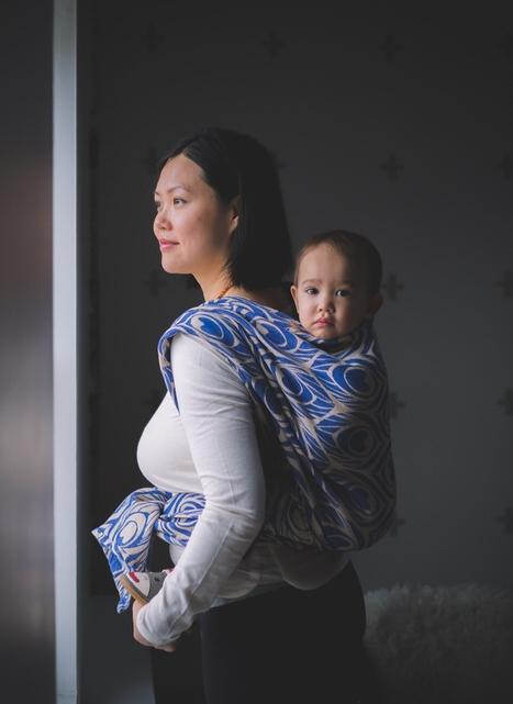 Babywearing in Ottawa by window in Artipoppe Wrap