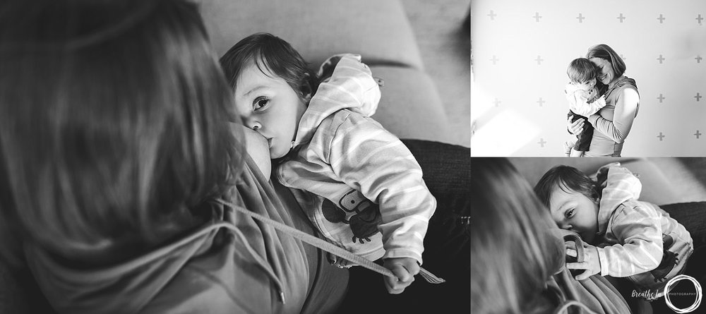 Baby nursing and cuddling with Mom during photo session indoors at Byward Market.