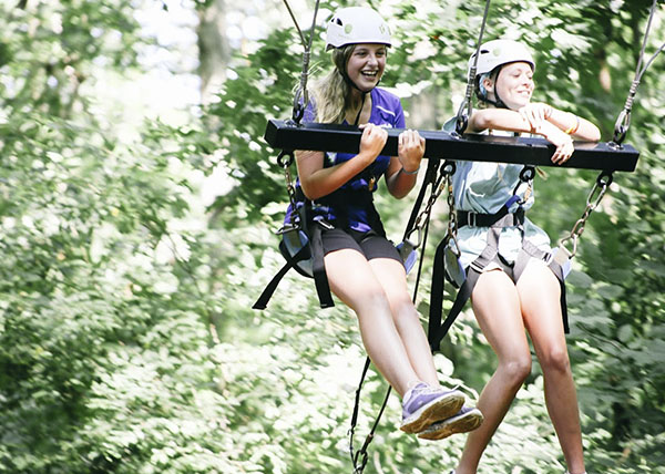 two_people_team_swing_highropes.jpg