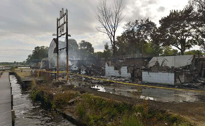 This is an August 2013 file photo, taken Aug. 2, 2013, of the aftermath of a fire that destroyed the Beach Club & The Dockside at Conneaut Lake Park along Conneaut Lake on Aug. 1, 2013. ANDY COLWELL/ERIE TIMES-NEWS
