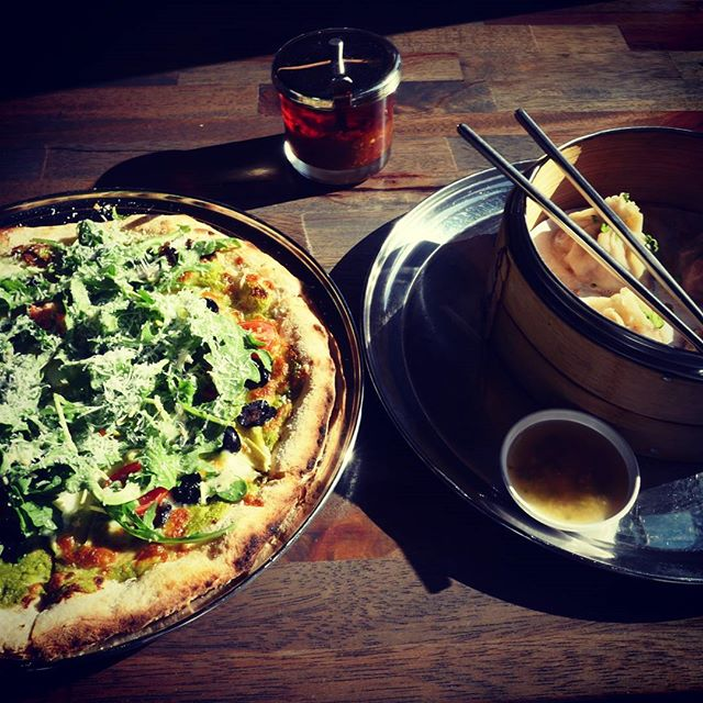 Our deck is open! Where else are you going to get pizza and asian dumplings outside on a sunny day? Pictured: p-patch pizza, chicken pho soup dumpling.  #pizza #dumplings #happyhour #seattle #fremont