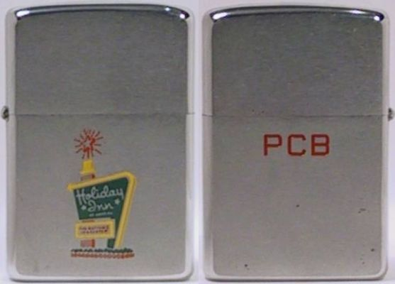 "This 1970 Holiday Inn Zippo with the initials PCB in red engraved on the reverse are for  Philo C. Blaisdell, the father of George Blaisdell, the creator of the Zippo  lighter. The front has an engraving of the iconic Holiday Inn ""Great Sign"" that greeted motorists across America. Founded as a U.S. motel chain, it has grown to be one of the world's largest hotel chains"