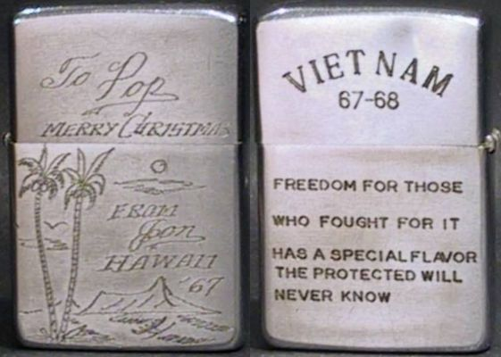 "1967 Zippo. One side is engraved ""To Pop, Merry Christmas, from John, '67"".  The other side apparently engraved in-field ""Freedom for those who fought, it has a special flavor the protected will never know""."