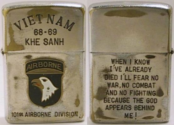 "1968 Zippo marked ""Viet Nam68-69 Khe San"" and with anattached badge of the 101st Airborne Screaming Eagle.  The back reads ""When I know I've already died I'll fear no war, no combat and no fighting because the God appears behind me"""