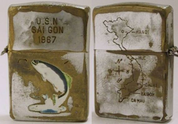 "This is a 1953 hand-painted Town & Country Trout Zippo which was many years later engraved with ""USN Saigon 1967"" and with a map of Vietnam on the back.  It was not unusual for the the servicemen to bring their own Zippos to Vietnam and have them engraved ""in-field"".  This is one of the oldest Vietnam War Zippos"