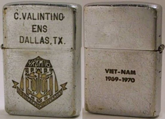 "1968 Zippo with the lid reading ""C. Valentino Ens. Dallas, Tx"" and the case engraved with the logo of YRBM16, a Repair, Berthing and Messing Barge, or tender for the  PBR's. The back reads""Viet-Nam 1969-1970"""