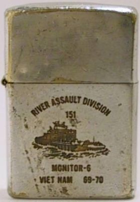 "1970 Zippo that reads ""River Assault Division 151, Monitor 6 Viet Nam 1970"" with the image of a monitor, or river gun boat"