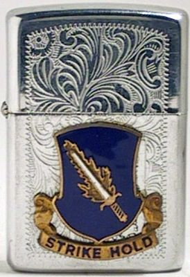 "1986 Venetian pattern Zippo with attached crest of the 504th Infantry Regimentwith the motto ""Strike Hold"""