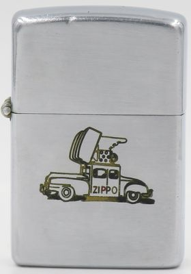 1946-49 Zippo with an engraving of the Zippo Car.  The Zippo Car built in 1947was a Chrysler Saratoga with two gigantic lighters sporting neon flames. It was was used for promotions at fairs, expos and parades but mysteriously disappeared sometime in the 1950's. In 1996, Zippo Mfg. Co. commissioned a replica of the original Zippo Car