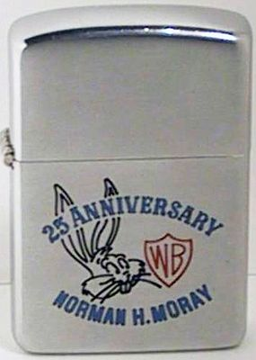 1954 Zippo for Warner Brothers 25th Anniversary with a graphic of Bugs Bunny, a cocky, wisecracking, good-hearted hare who battled Elmer Fudd, Daffy Duck and other slapstick opponents. It is also engraved with the name of Norman H. Moray who was involved in the production of Loney Tunes' Rocket Squad featuring Daffy Duck and Porky Pig. Mr. Moray was a key executive of Warner Bros' Vitaphone short subject division, most famous for Looney Tunes and Merrie Melodies