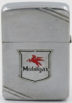 "1937 Zippo with a metallique logo for Mobilgas.  It has a graphic of a Pegasus, or flying Company of New York in 1911.  Not shown is the obverse with the initials ""EAVD"""