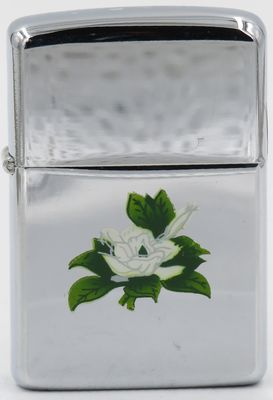 1961 Town & Country Zippo with an engraved gardenia.  The reverse not shown has advertising for Grand Hotel in Point Clear Alabama