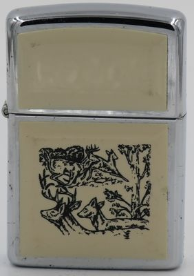 1990 scrimshaw Zippo with images of deer in the woods