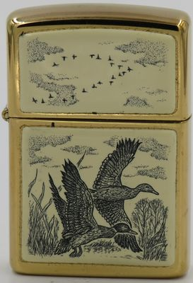1991 Scrimshaw Zippo with ducks in flight.  No acrylic panels on the reverse