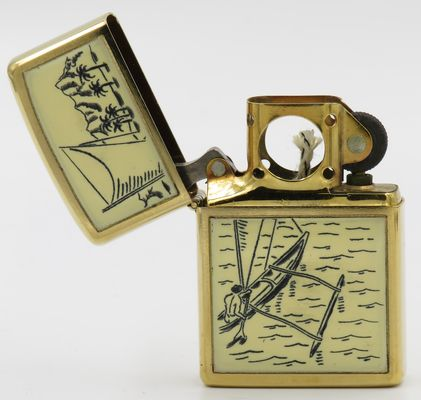 This 1977 Scrimshaw Zippo Outrigger has a pipe lighter insert