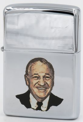 This is a rare 1969 T&C Zippo with the image of George Blaisdell, the founder of Zippo Manufacturing Co.