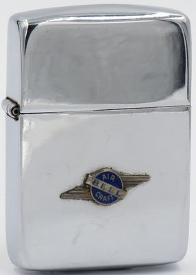 1942-1945 Zippo with a Bell Aircraft badge attached