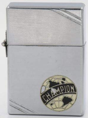 This is a rare and unusual 1934 Zippo with an original outside hinge and an early metallique logo for the Champion, which is named after Albert Champion, a French immigrant who started Champion Ignition Company in 1904 to produce spark plugs. The lighter still has most of the original paint.