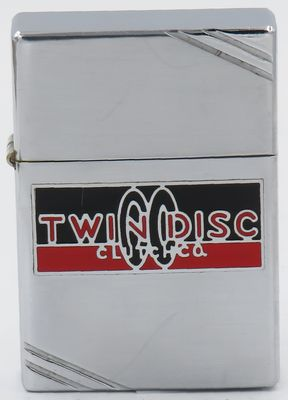"1936 Zippo with an early logo for Twin Disc Inc in metallique.  Founded in 1918 by P.H. Batten in Racine Wisconsin, Twin Disc Inc introduced the first ""twin disc"" clutch for farm tractors"