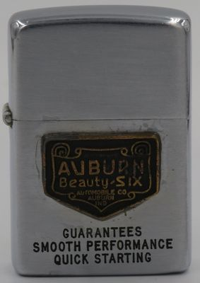 "1949-50 Zippo with a badge for ""Auburn Beauty-Six"", a motorcar introduced in 1919 by Auburn Motor Company.  Founded in 1903, the Company went out of business in 1937, a victim of the Great Recession. Badges attached to Zippos can be added years later, by anyone."