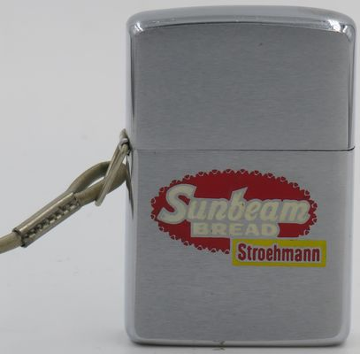 1965 loss-proof Zippo advertising Sunbeam Bread by Stroemann.  Sunbeam Bread is a franchised brand of white bread, rolls, and other baked goods owned by the Quality Bakers of America cooperative.