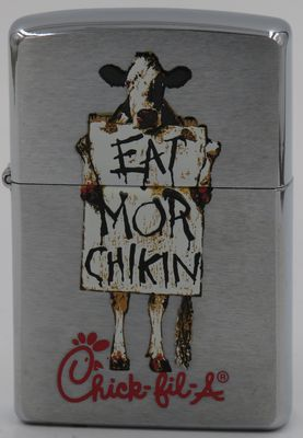 "1999 Zippo  for Chic-Fil-A with a sad looking cow with a sign ""Eat Mor Chikin"""