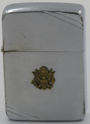 This is a 1940-41 model Zippowith an attached seal of the United States.