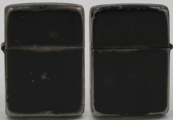 This is a typical 1942-45 World War II black crackle Zippo. It is made of steel (distinguishable with a magnet) and the paint along the edges has been worn down or chipped from regular use.