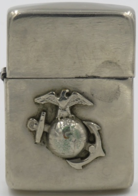 High-polish 1943 Zippo with the US Marine Corps' emblem attached.