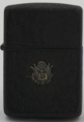 1942-45 black crackle Zippo with an attached Seal of the United States Army.