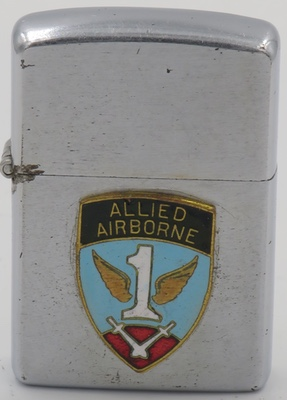 1952-53 Zippo with an attached badge with the logo of the First Allied Airborne Army