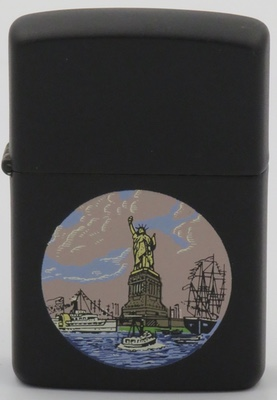 1984 Zippo, possibly a prototype, with a Statue of Liberty in unusual colors  with graphics types of ships on a black matte finis