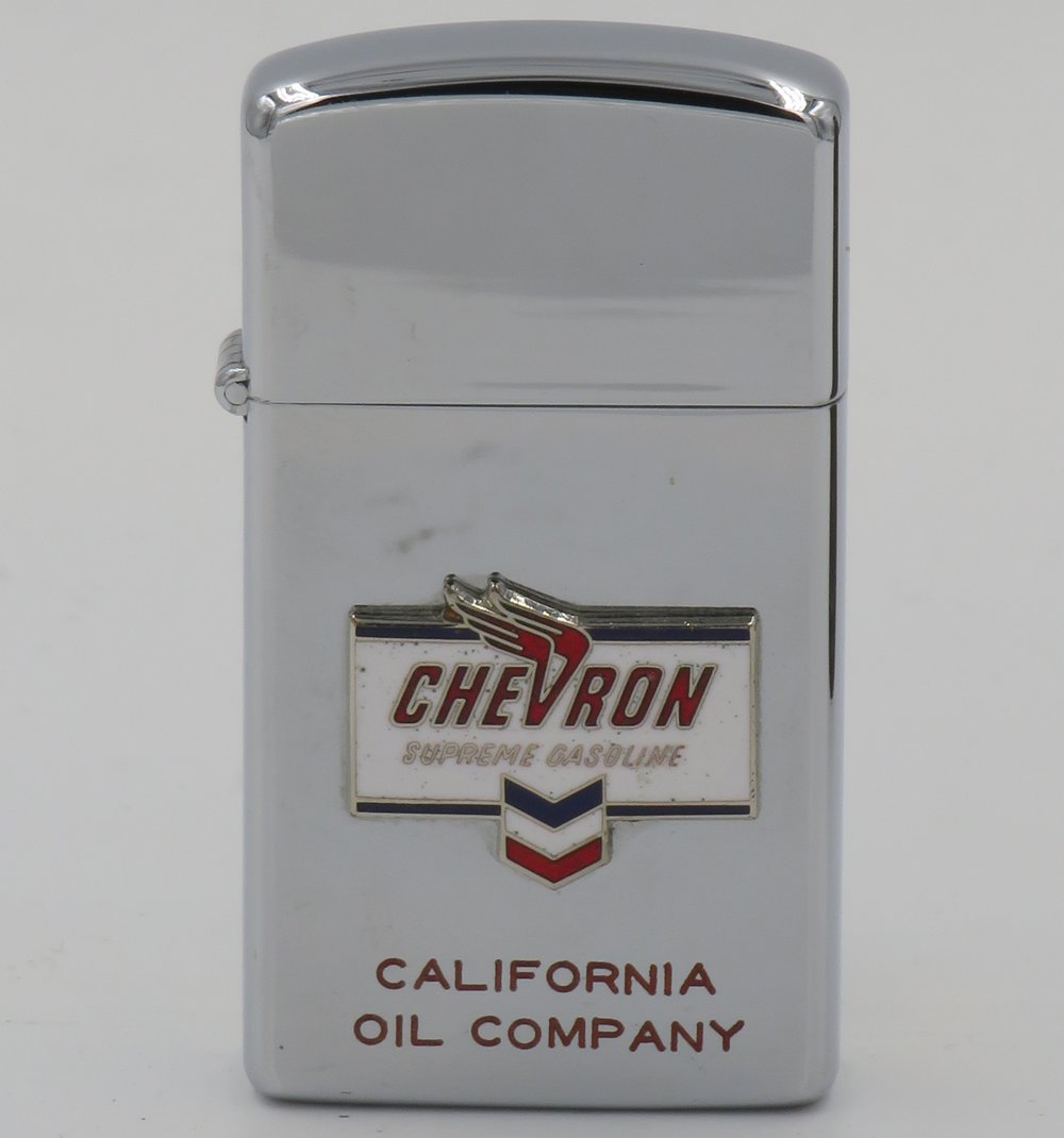 "Chevron slim 1961 slim Zippo with Chevron Supreme Gasoline attached badge and ""California Oil Company"" engraved"