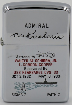 This 1962 Zippo  also commemorates USS Kearsarge's recovery of Walter Schirra after the 9 hour Mercury 7 orbit mission in October 1962 and Gordon Cooper after the Mercury 8 orbit in May 1963 . It is a presentation lighter got  Admiral Constantine Karaberis