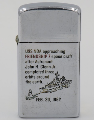 This 1962 slim Zippo commemorates the recovery of John Glenn by USS Noa after completion on the Mercury 3 mission which was the first US manned orbit of the Earth in February 1962