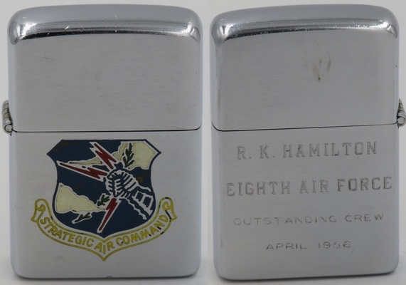 "1956 Zippo engraved with the logo of the Strategic Air Command.  The reverse has been personalized for ""R. K. Hamilton Eighth Air Force Outstanding Crew April 1956"""