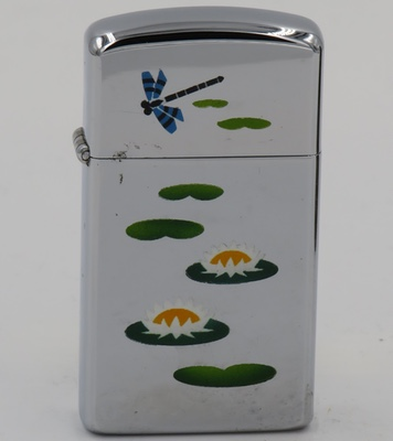 1969 slim Zippo with the classic lily pond design rarely seen on a slim Zippo