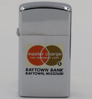 1977 slim Zippo Master Charge The Interbank Card Raytown Bank, Ratown, Missouri. The Interbank Card Association, known as Master Charge, was founded in 1966 for the purpose of sharing the cost of bank credit card processing across many banks