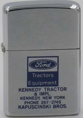 1973 Zippo advertising Ford and Kennedy Tractor and Implement Co. in Kennedy New York owned by the Kapuscinski Brothers