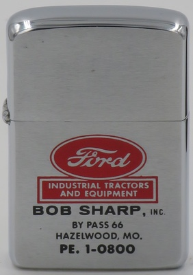 1959 Zippo advertising a Ford Industrial Tractor Dealership in Hazelwood MO serving metropolitan St. Louis.  Started by Bob Sharp in 1958, In 1990 Mr. Sharp sold his tractor dealership and retired