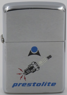 1968 Zippo with a graphic of a sparkplug.  Prestolite Electric is a global manufacturer and supplier of alternators, starters, electrical equipment, and services to the transportation, industrial, military, marine, agricultural and construction industries