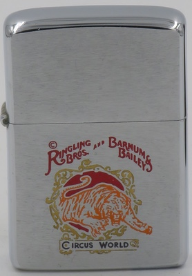 1975 Zippo for Ringling Bros. And Barnum & Bailey Circus World with the image of a fierce tiger leaping through a fiery ring. The Ringling Bros. and Barnum & Bailey Circus is a famous American circus, formed when the Ringling Brothers purchased the Barnum and Bailey Circus in 1907.
