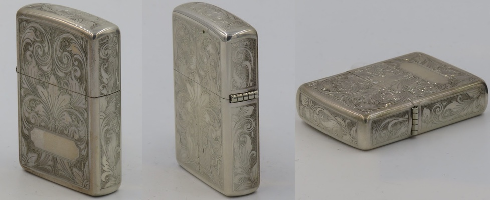 Ornate 1967 Sterling Zippo with ornate design on all sides