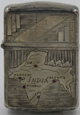 "c1945 Sterling Lighter with ornate map of India with red stones marking the major cities Delhi, Karachi, Bombay, Madras and Calcutta.  The bottom is marked ""Silver"""