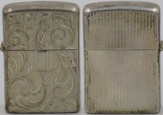 1950's prototype Sterling Venetian small plaque 2.JPG1950's Sterling Zippo with Venetian design with a small space for personalization and engine-turned vertical lines on the reverse